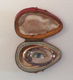 """Eye miniature pin painted on ivory  dated 1785 set in 18K gold.  Inscription on reverse """"OB 6 Mar 1785 at 53."""" Leather box."""