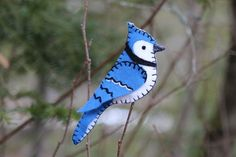 Bold Blue Jay Felt Ornament - I would love a bunch of cardinals like this to decorate the house with at Christmas