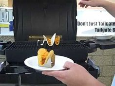 I recently discovered a new product that helps you cook and serve tacos on a BBQ grill. The Taco Rack warms taco shells standing up so you can fill them with meat and then melt the cheese right in the shell. Makes a cool tailgating gadget too in that the Taco Rack fits onto your grill grate and holds the tacos upright. The racks fold flat and are perfect for the tailgater looking for a new menu choice at the stadium