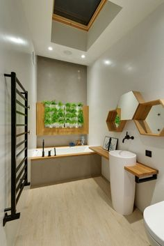19 Ideas For Using Hexagons In Interior Design And Architecture // A Wood-framed hexagonal mirror and shelves have been included in this bathroom to add some decorative flair.