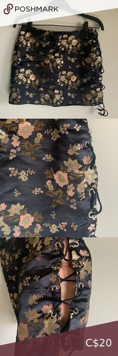 Black Satin Mini Skirt Mini Skirt Black with floral print Has a slit with a stretchy ribbon criss crossing along the side Size Small but really fit Zipper on the back Fashion Nova Skirts Mini Black Satin, Skirt Fashion, Nova, High Waisted Skirt, Floral Prints, Mini Skirts, Ribbon, Zipper, Fit
