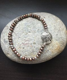 Freshwater Pearls and Silver Sand Dollar Stretch by Kosmikchic