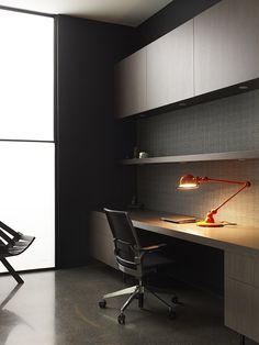Smooth and clean integrated workspace with shelving and cabinets.