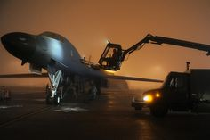 Airmen from the Bomb Squadron work to de-ice a Lancer March at Ellsworth Air Force Base, S.D, in preparation for a mission in support of Operation Odyssey Dawn. B1 Bomber, Bomber Plane, Military Jets, Military Aircraft, Air Fighter, Fighter Jets, Chopper, Rockwell International, Aircraft Maintenance