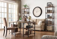 Factory Collection Writing Desk 3228-15Blending the look of vintage industrial with modern design is the Factory Collection. Burnished rustic wood planks make up the desk top and features wrought iron style metal framing that supports both the top and the wooden display shelves. The continuous finished design makes this unit flexible for placement as a freestanding piece. Matching bookcase and occasional tables are also available.Features:Factory CollectionRustic StyleRustic Oak…
