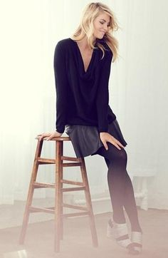 Pair a dark cashmere sweater with a leather skirt.