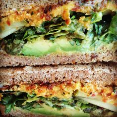 This big ass breakfast sandwich has avocado, arugula, romaine, cucumbers, Debbie's homemade roasted carrot and sweet potato hummus, sun-dried tomato spread, dill pickles and Vegenaise on seeded bread. This is so delicious and satisfying! Recipe for hummus here: http://tinyurl.com/lreu2lr