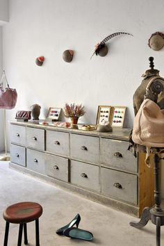 Love the hat blocks on the wall and the drawers to die for.