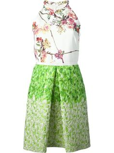 White, pink and green cotton and silk blend sleeveless dress from Giambattista Valli featuring a halter neck, pink and white floral printed top, and a green skirt with a front box pleat.