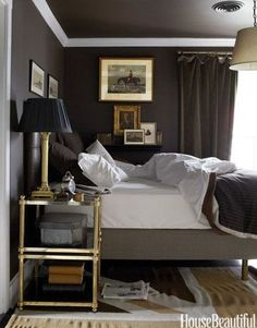 """A boy's """"espresso""""-colored bedroom feels surprisingly grown up in Annie Brahler's Illinois home. The designer matched Behr paint and a Jonathan Adler Union Jack rug to colors on a Vuitton bag. If you're looking to shake up your home's design with the changing seasons, a dark shade like this one is a good bet. Click through for more autumn color schemes for fall decorating."""