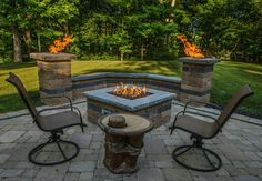 paver patio with raised fire pit area and sitting wall with