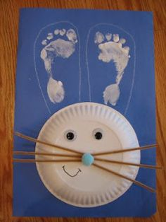 bunny craft with footprint ears- attach the papper plate (dessert size) & pipe cleaner whiskers using a T-brad! Pretty easy & very cute!