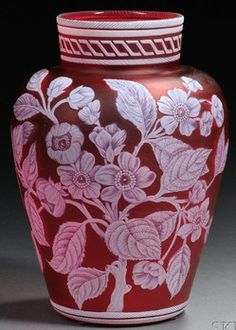 "Year: 	1890 - 1920 A Thomas Webb & Sons Cameo glass vase, Stourbridge, England, late 19th to early 20th century, inverted baluster form with a squat collar decorated with incised white cameo bands, body with an apple blossom motif, a moth, and a maidenhair fern on a red ground, marked ""THOMAS WEBB & SONS/CAMEO"" in a banner to underside."