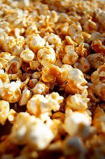 My Amish Friend's Caramel Corn  Allrecipes.com     7 quarts plain popped popcorn  2 cups dry roasted peanuts (optional)  2 cups brown sugar  1/2 cup light corn syrup  1 teaspoon salt  1 cup margarine  1/2 teaspoon baking soda  1 teaspoon vanilla extract