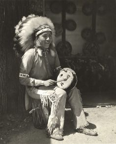 [Native American drumming]