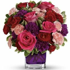 Blossoming with unmatched color and texture this fresh flower blossoming with unmatched color and texture this fresh flower arrangement brings together pink roses hot pink roses purple stock hot pink carna mightylinksfo