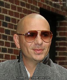 Pitbull Photo http://www.icelebz.com/events/pitbull_and_iggy_azalea_spotted_outside_ed_sullivan_theater_for_late_show_with_david_letterman/photo7.html