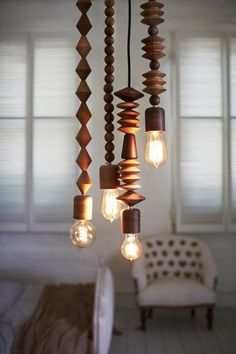 Beads pendant lights, crafted and sculptured from wood by Sydney based Marz Design. Easy to use a hook to get the lights in any spot you like.