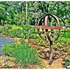 Garden Globe - old barrel rings - bolts & nuts - tree branch