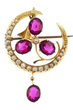 An early 20th century 9ct gold split pearl and garnet pendant. The seed pearl crescent with oval-shape garnet and seed pearl floral centre, to the oval-shape garnet drop and seed pearl surmount. May be worn as a brooch. Length 4.7cms.