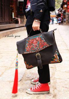 dark brown split leather shoulder bag Hmong/Tribal style, with vintage embroidered piece, vintage redesign. $149.00, via Etsy.
