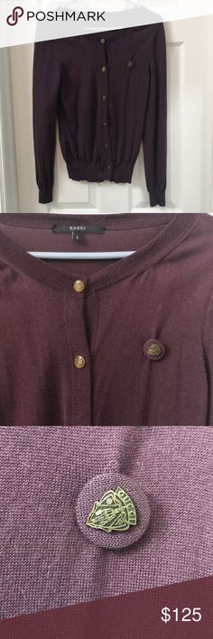 Purple Gucci cardigan Good condition! Lightly worn. Reason price is so low is because it has a small hole next to the buttons, could easily be stitched up. Just don't have the time to do it myself. Comes with a pin attached, and detailed buttons Gucci Sweaters Cardigans