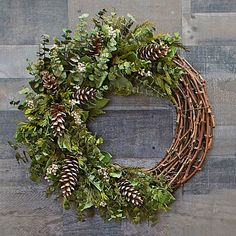 Hope Ranch Holiday Wreath Sprigs of preserved Eucalyptus, clusters of white Pepperberries, and classic Pine cones come together amid the greenery of Cedar and Salal to create this lavish holiday wreath. Diy Wreath, Door Wreaths, Christmas Diy, Christmas Decorations, Pine Cone Decorations, Christmas Quotes, Christmas Pictures, White Flower Farm, Greenery Wreath