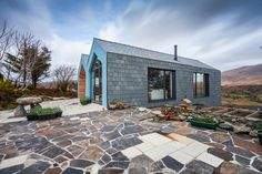 An eco-friendly, split-level house in Castletownbere, West Cork, won RTE One's Home of The Year — We are very happy we were able to shoot this beautiful house Eco Buildings, West Cork, Ireland Homes, Clever Design, First Home, Beautiful Homes, House Design, Patio, Architecture
