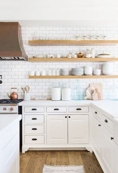Modern Kitchen Interior Remodeling Open Kitchen Shelves Instead of Cabinets: Bright white modern kitchen with open wood shelves and white subway tiles Kitchen Tiles, Kitchen Dining, Kitchen Decor, Kitchen White, Kitchen Countertops, Dark Countertops, Space Kitchen, Decorating Kitchen, Warm Kitchen