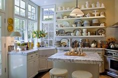 Open shelving and marble countertops