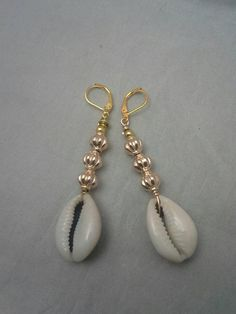 If you own valuable fashion jewelry such as diamond earrings, pendants, diamond rings, or other fine precious jewelry products, you can keep these items for a life time if you take care of them. Cowrie Shell Necklace, Shell Earrings, Shell Necklaces, Beaded Earrings, Beaded Jewelry, Hoop Earrings, Fashion Necklace, Fashion Jewelry, Coin Jewelry