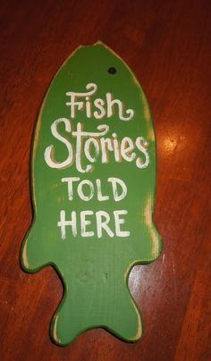 """Hand painted  """"Fish Stories Told Here"""" wooden fish sign on Etsy, $11.00"""