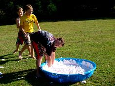 Obstacle course idea! Find the flag in the pool full of water balloons and shaving cream to stop the clock! #wipeoutparty