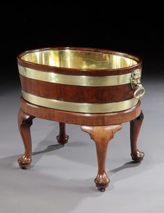 A GEORGE II BRASS BOUND MAHOGANY WINE COOLER. English, circa 1755