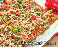 30 mins to make,serves 12 -- INGREDIENTS  -- MEAT • 2 1/2 oz Italian sausage, cooked PRODUCE • 2 Basil, fresh leaves • 1 cup Broccoli, cooked • 1 Plum tomato CONDIMENTS • 1/3 cup Spinach dip, prepared OILS & VINEGARS • 1 tbsp Olive oil SNACKS • 24 Triscuit fire roasted tomato & olive oil crackers DAIRY • 1/4 cup Mozzarella cheese • 1 tbsp Parmesan cheese, grated