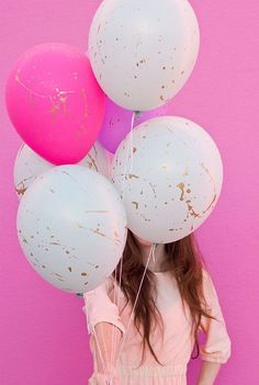 These paint splatter balloons are perfect for gals planning parties on a budget.: