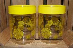 """Vintage Corning Bright Yellow Daisies Glass Canister Set  These are wonderful glass Corning (Pyrex) glass canister jars. It has a bright happy daisy design in bright yellow. The top is a hard plastic with a seal and just snaps on. It is a great size and stands 6"""" high and is 4.5"""" in diameter.  $18.50"""