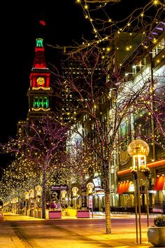 DENVER COLORADO / U. - December Holiday light display along Denver's Street Mall with historic landmark the Daniel Fisher Tower in distance with red and green lights on December 2014 in Denver, Colorado Christmas In The City, Christmas Feeling, New York Christmas, Christmas Night, Beautiful Christmas, Xmas, Vintage Christmas, Merry Christmas, Denver Colorado
