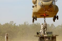 Paratroopers assigned to 782nd Brigade Support Battalion, 4th Brigade Combat Team, 82nd Airborne Division, wait to hook their sling up to a U.S. Army CH-47 Chinook helicopter during a sling load training exercise on Fort Bragg, N.C #USArmy
