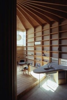 each of those radial beams lines up with shelving support.  design boner.  Tree House - Tokyo, Japan