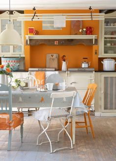Orange kitchen - http://orangekitchendecor.siterubix.com/ Love the mix and match chairs at this kitchen table!  #ppgorange