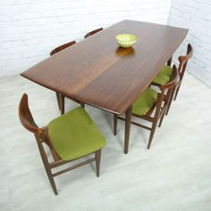 Beautiful walnut dining set- like the green accent on the chair cushions. We could do a fun color if you wish or black vinyl.