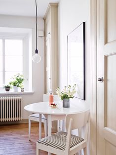 Mix of vintage and contemporary. Like the thin picture frame, pendant light fitting, cupboards.