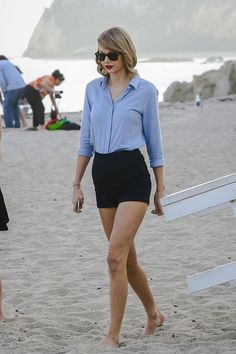 blue shirt and black high waist short pants.  (Taylor Swift)