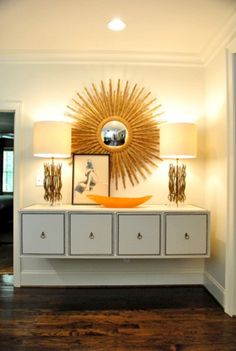 "A wall-mounted, ""floating"" credenza will make your foyer seem larger."