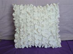 White ruffled pillow
