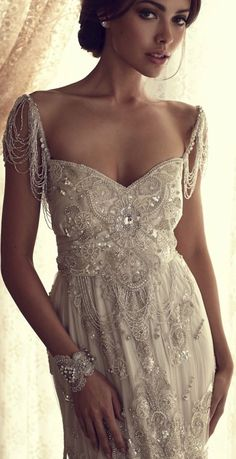 Wow! Beautiful. http://www.froufroulebleu.com/wp-content/uploads/2013/09/anna-campbell-beaded-vintage-wedding-dress-art-deco-5.jpg