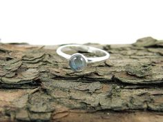 Labradorite Gemstone Ring, Sterling Silver and blue with orange aurora flash gemstone ring I have made the ring from solid D shape 1.5mm thick sterling silver wire which had been hammered and shaped and fitted with a bezel. The bezel holds a 6mm beautiful labradorite gemstone in a