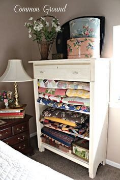 quilt display cupboard made from a dresser with the drawers removed