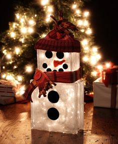 snowman lighted block... Sm & Lg glass blocks, white paint (sponged on) black paint (eyes,mouth, buttons) orange paint (nose).